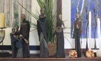 Small statues on a shelf