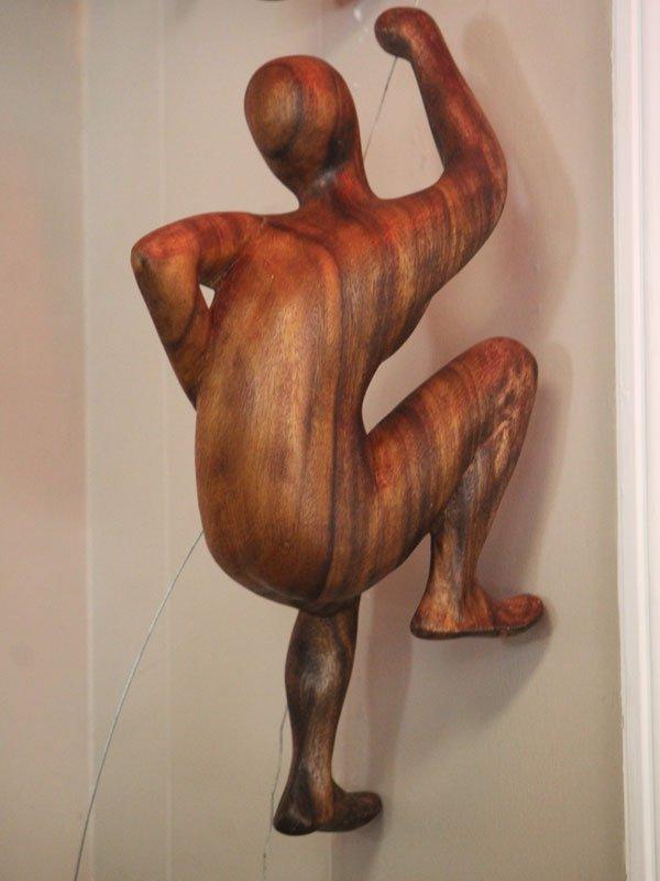 Climbing Wooden Statue